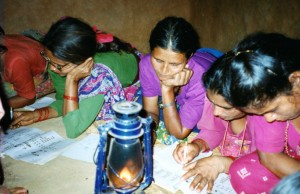 Litteracy classes through the GWA held by lamplight as there is no electricity